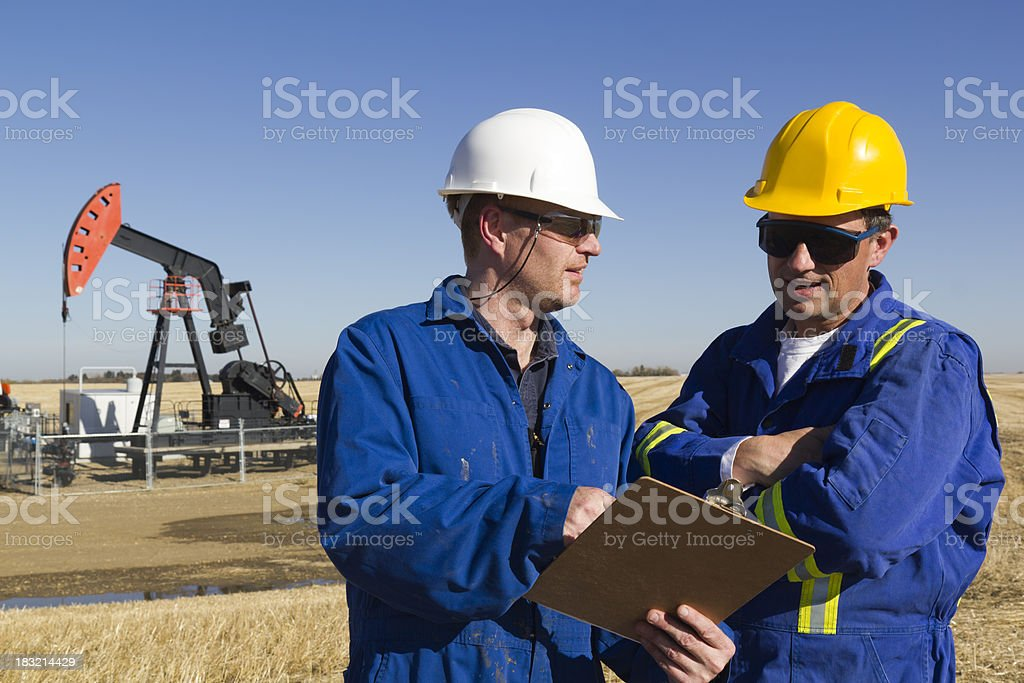 Oil Engineers on Site royalty-free stock photo