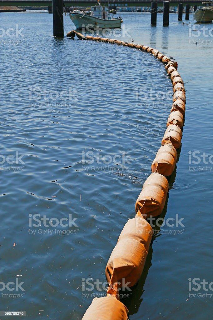 Oil fence of the sea surface foto de stock libre de derechos