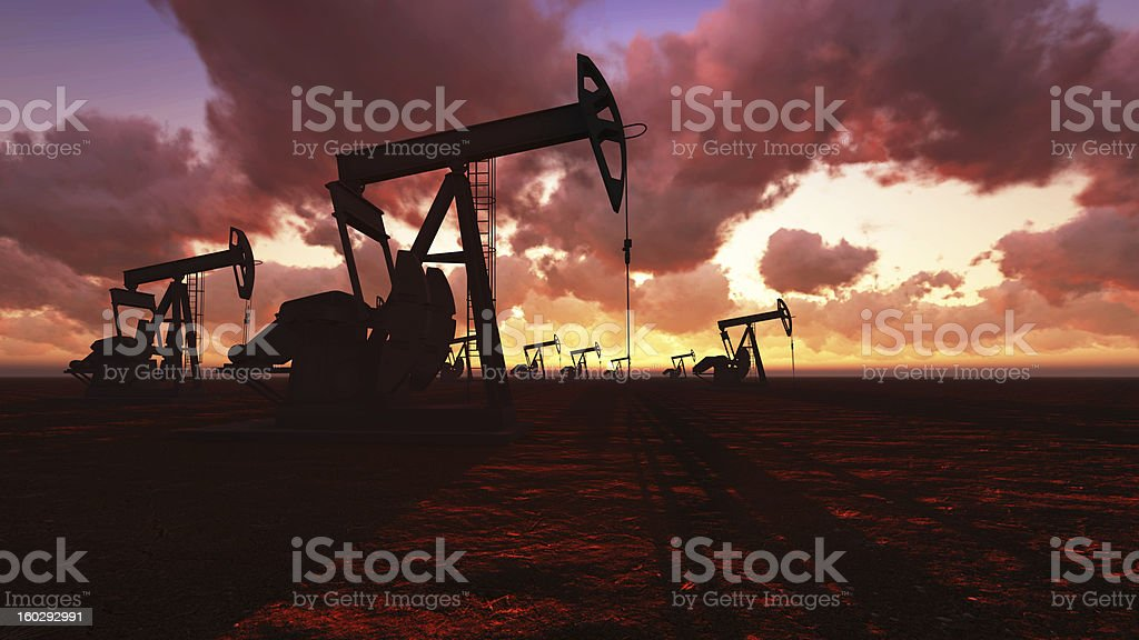 Oil field at  sunset royalty-free stock photo