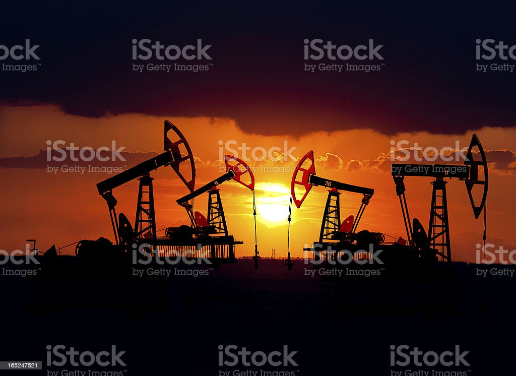 Oil field at sunset. stock photo