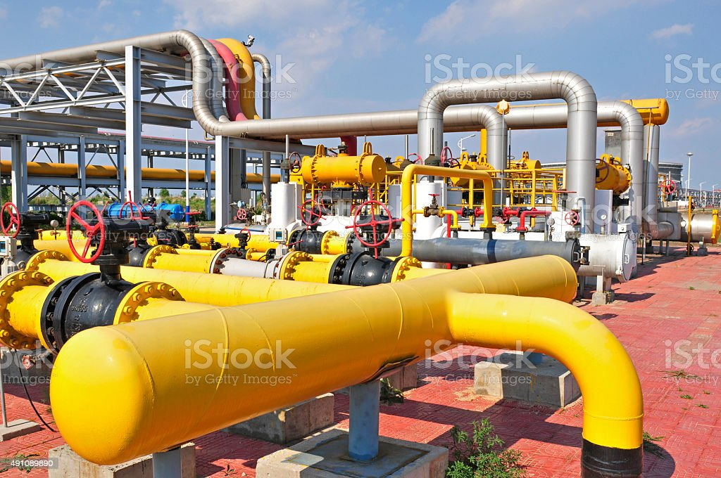 Oil field pipelines and valves stock photo