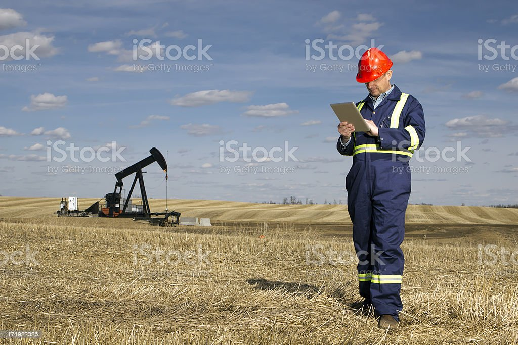 Oil Field Worker and Tablet PC royalty-free stock photo