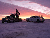 Oil Field Workers at Sunrise