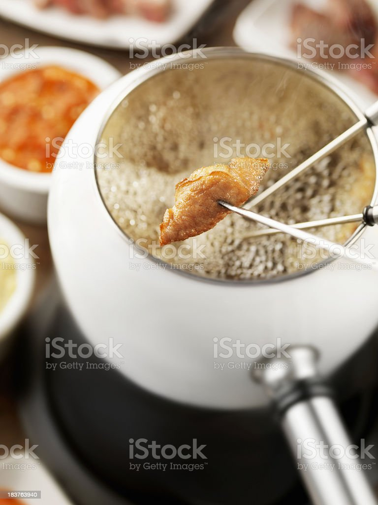 Oil Fondue with Chicken stock photo