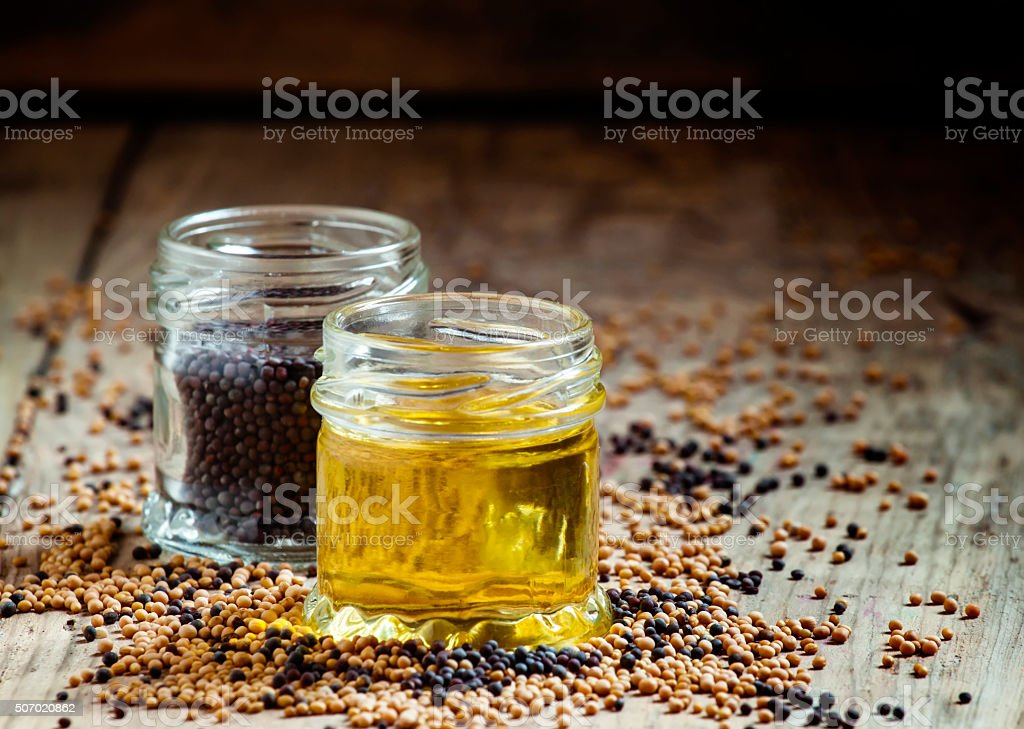 Oil from the seeds of the black mustard stock photo
