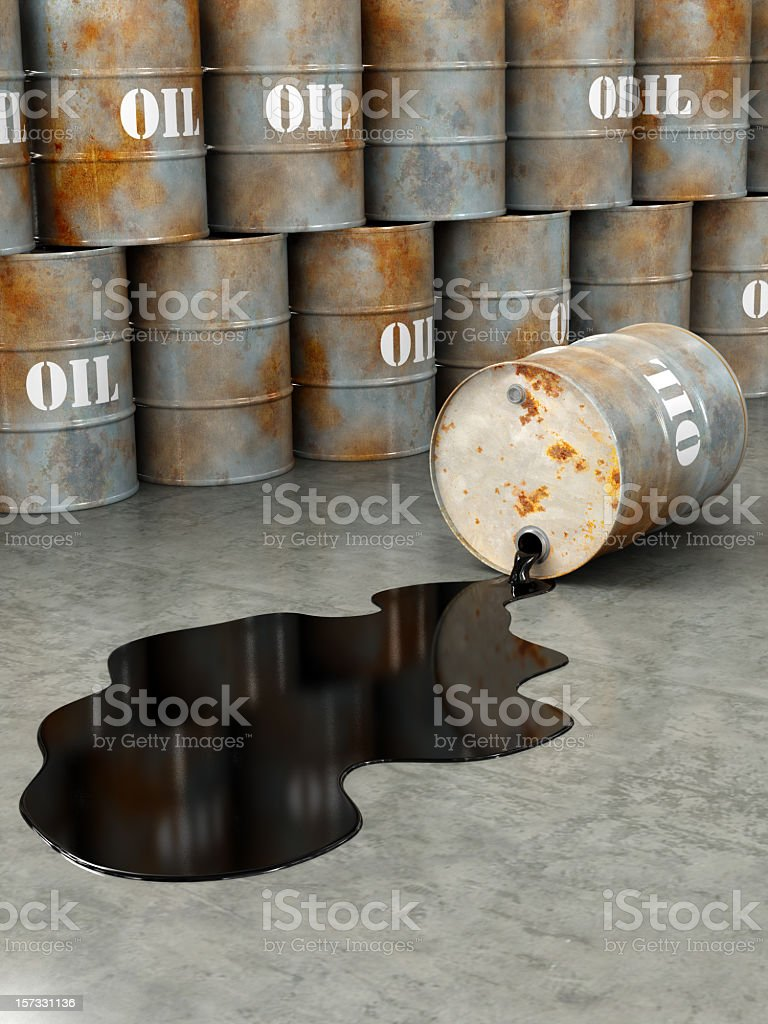 Oil gallons stacked and one gallon spilling oil stock photo