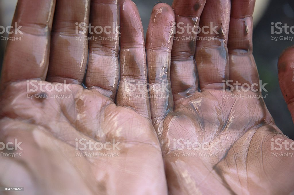 Oil hands royalty-free stock photo