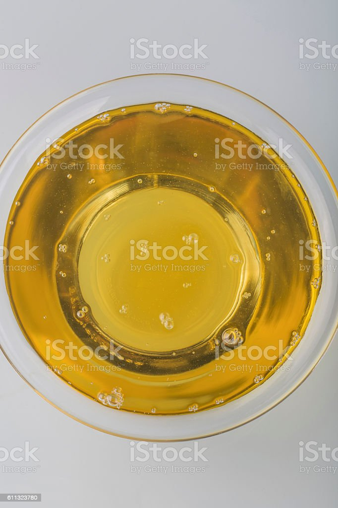 Oil in a glass bowl stock photo