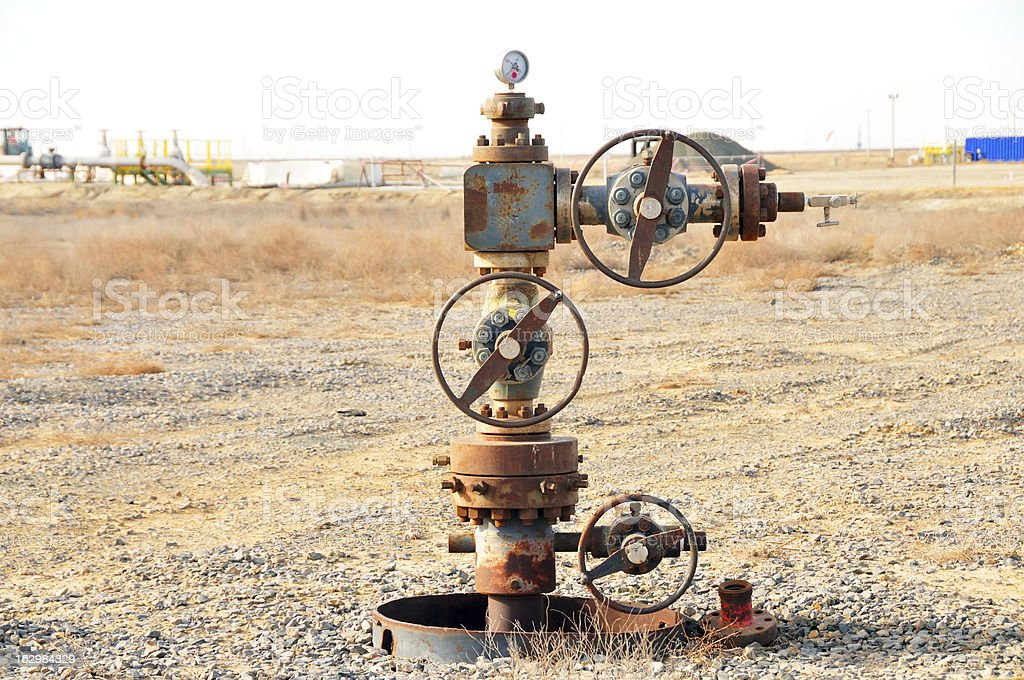 Oil industry: Abandoned wellhead stock photo