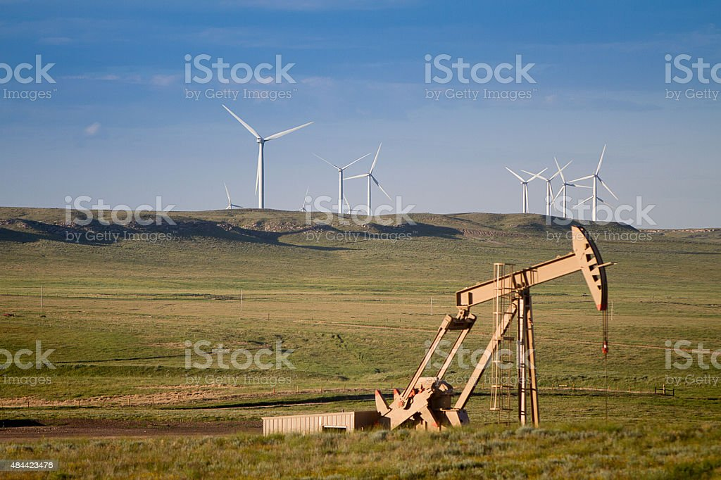 Oil Industry Pumpjack well with Commercial Turbines stock photo