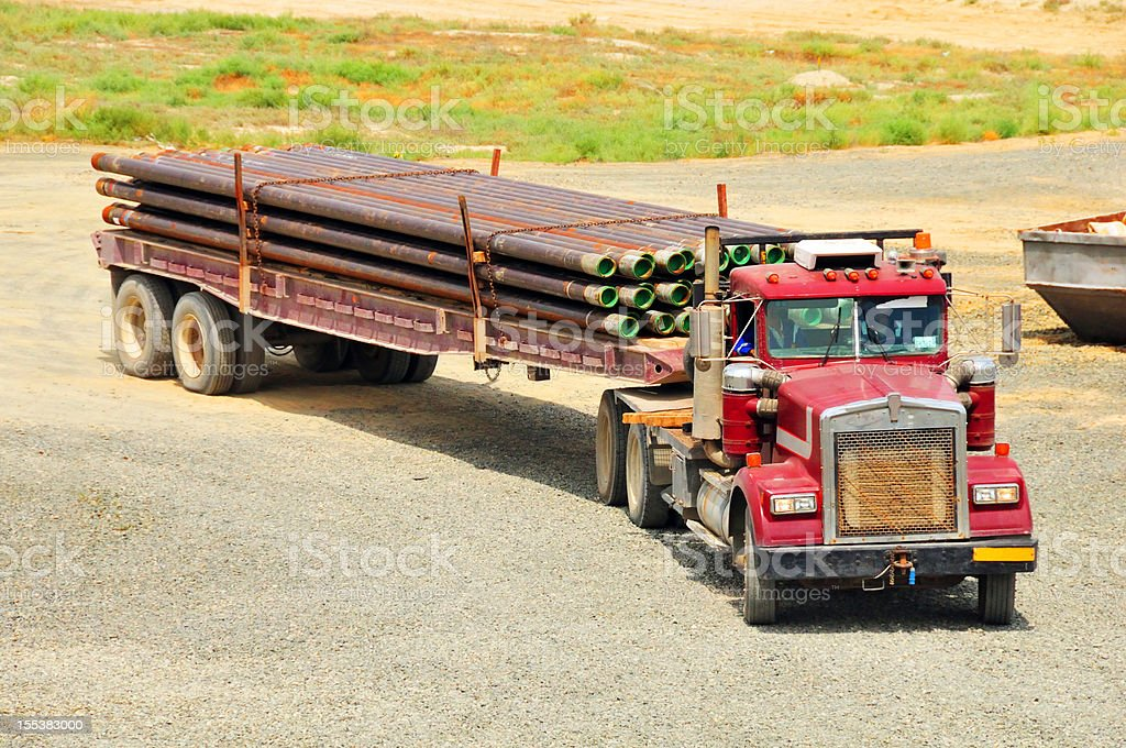 Oil industry: Transporting casing stock photo