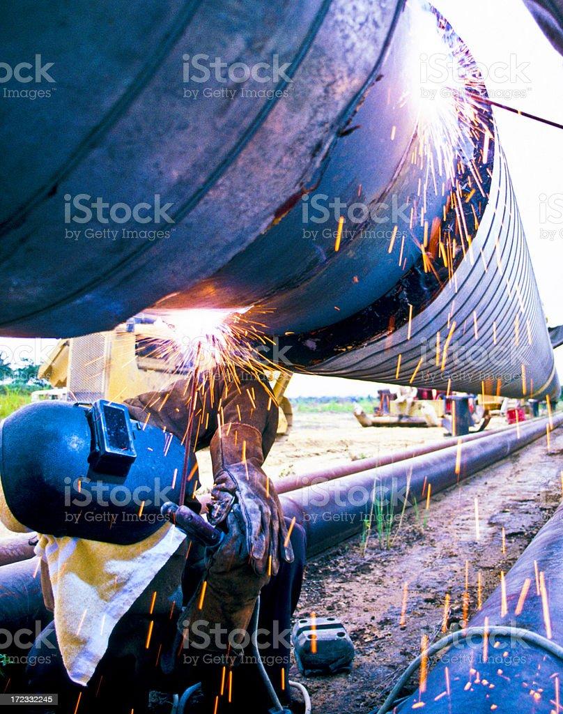 Welding oil pipe.