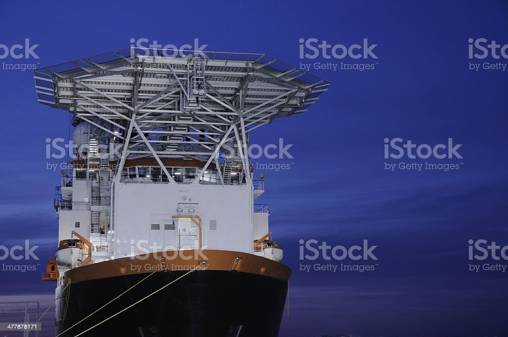 Oil industry work vessel at night stock photo