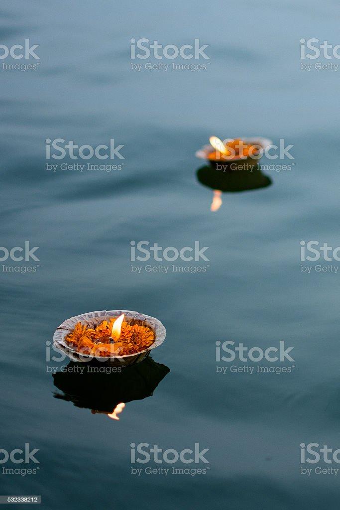 oil lamp floating in river stock photo