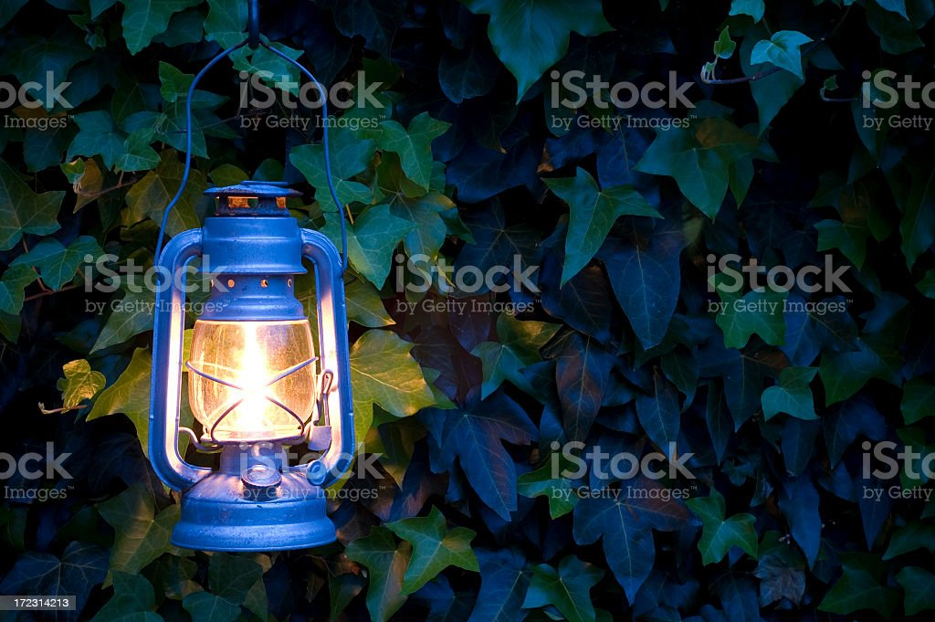 Oil lamp illuminating an outside environment stock photo