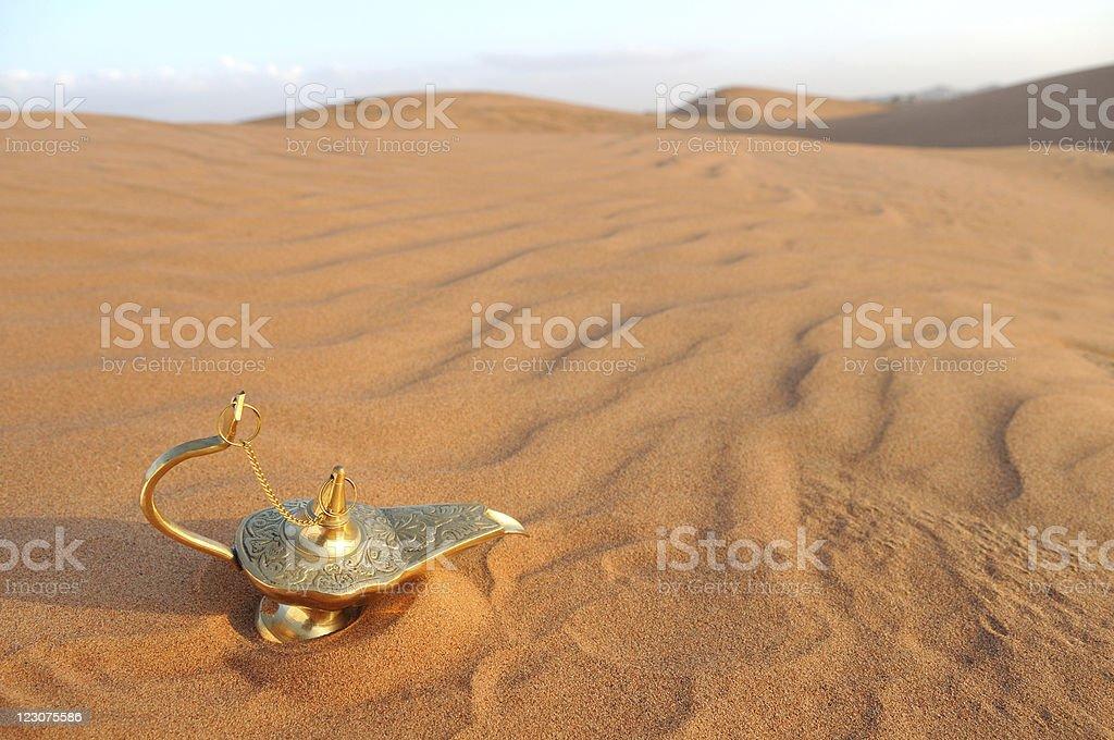 oil lamp in a desert stock photo