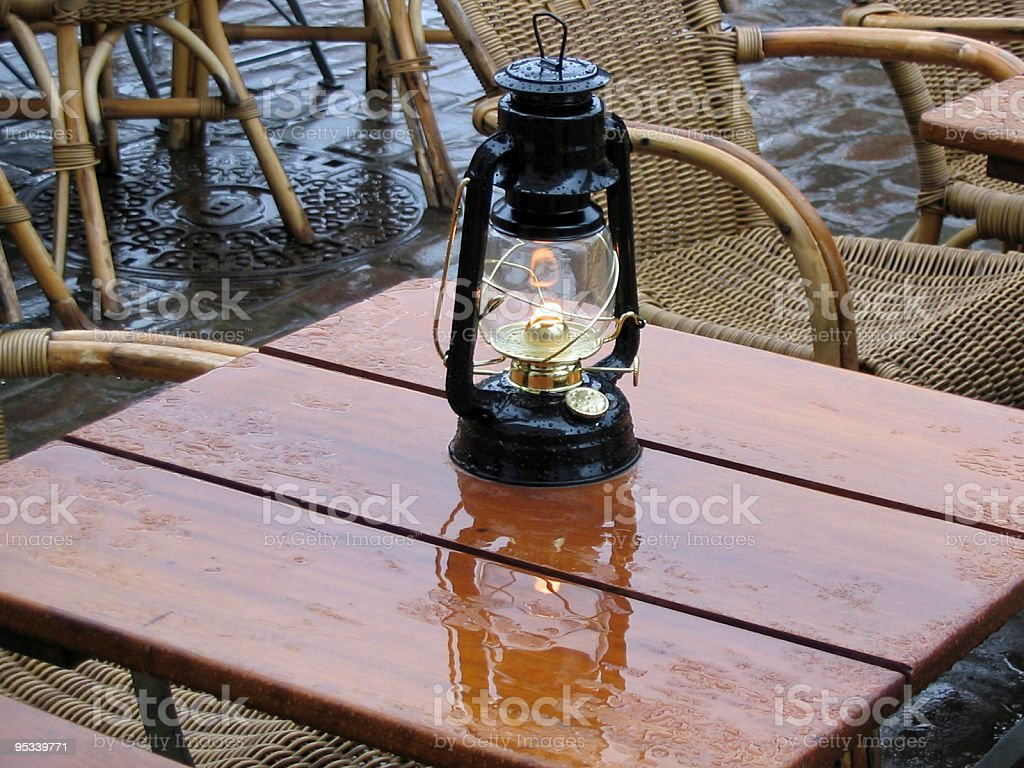 Oil lamp on a coffee table royalty-free stock photo