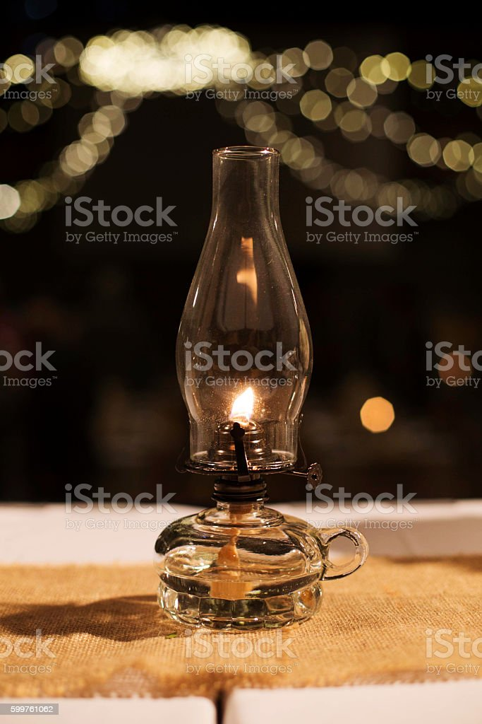 Oil Lamp on a Table stock photo