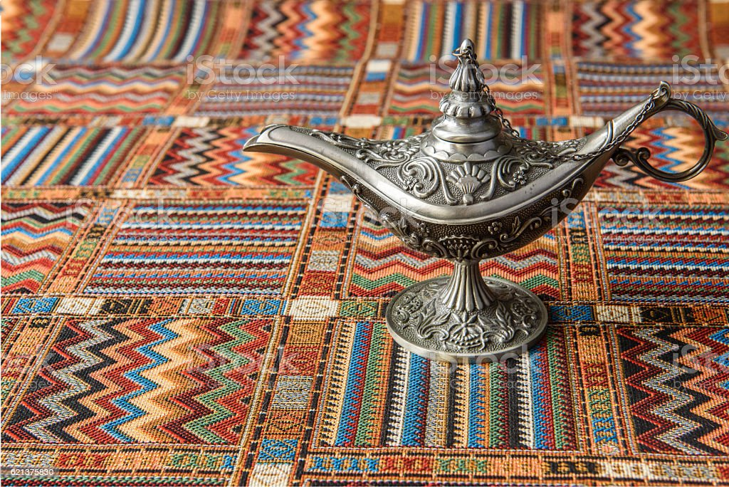 Oil lamp on a traditional Arabic carpet stock photo