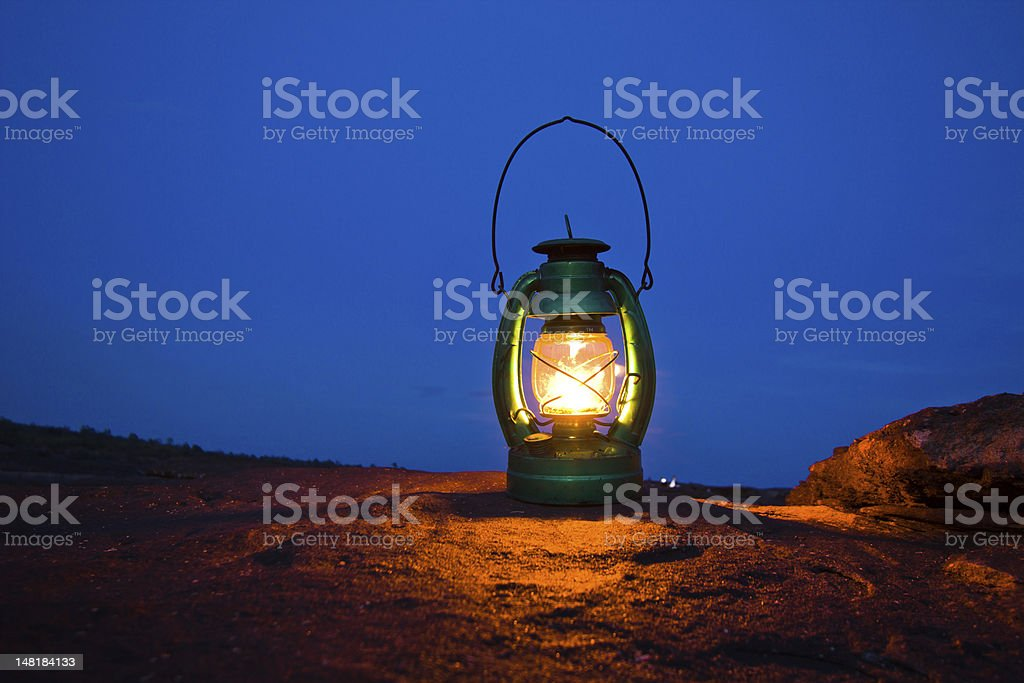 Oil lamp on Mountains at night stock photo