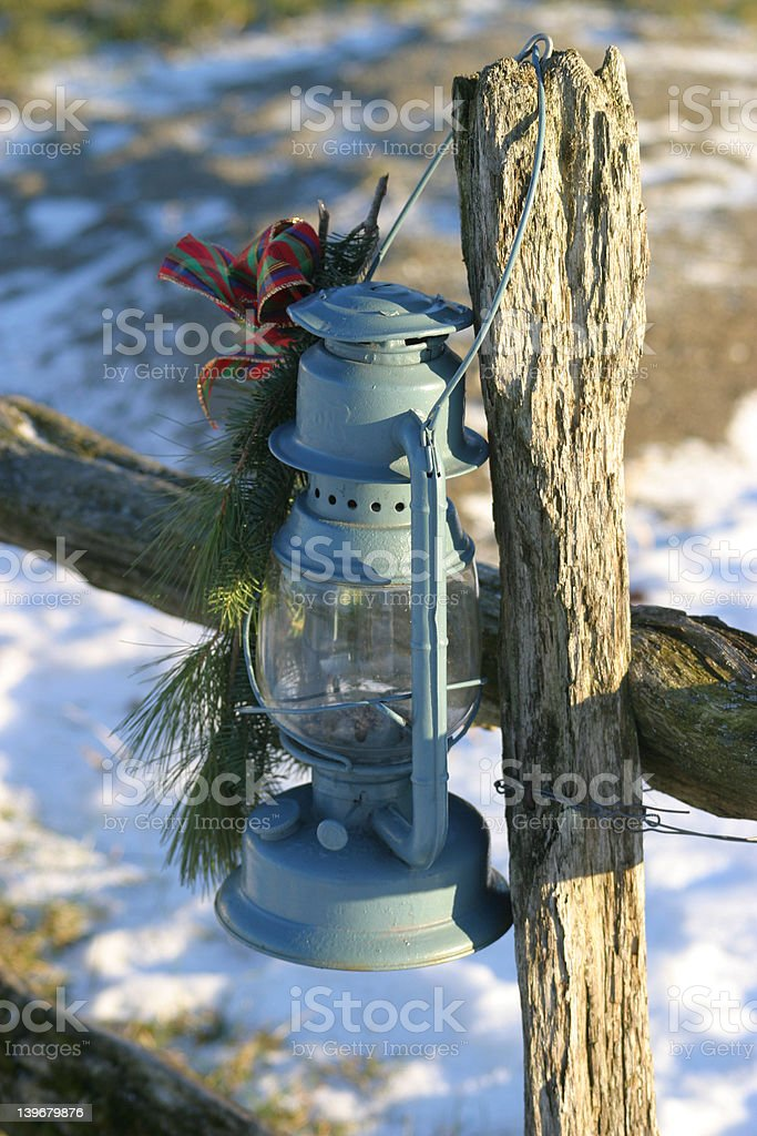 Oil Lamp on Wood Fence royalty-free stock photo