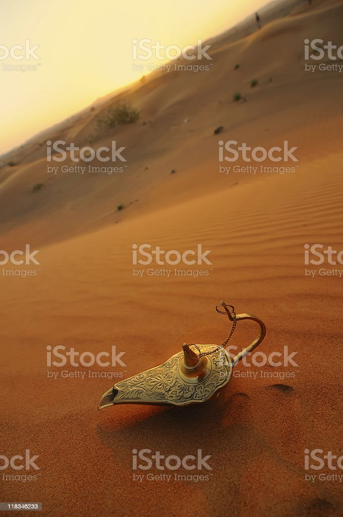 Oil lamp placed on the sand dunes stock photo