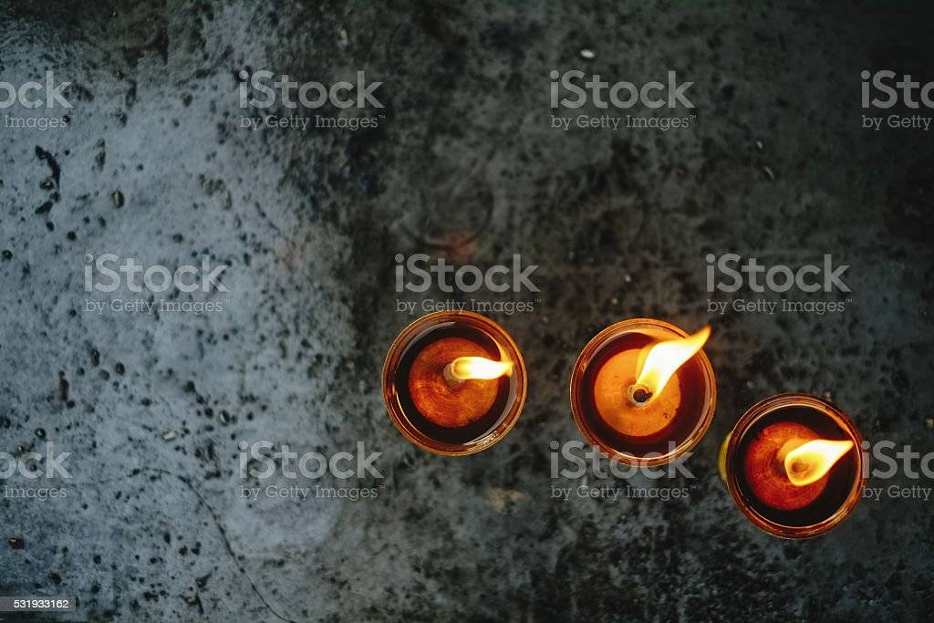Oil lamps in the temple stock photo