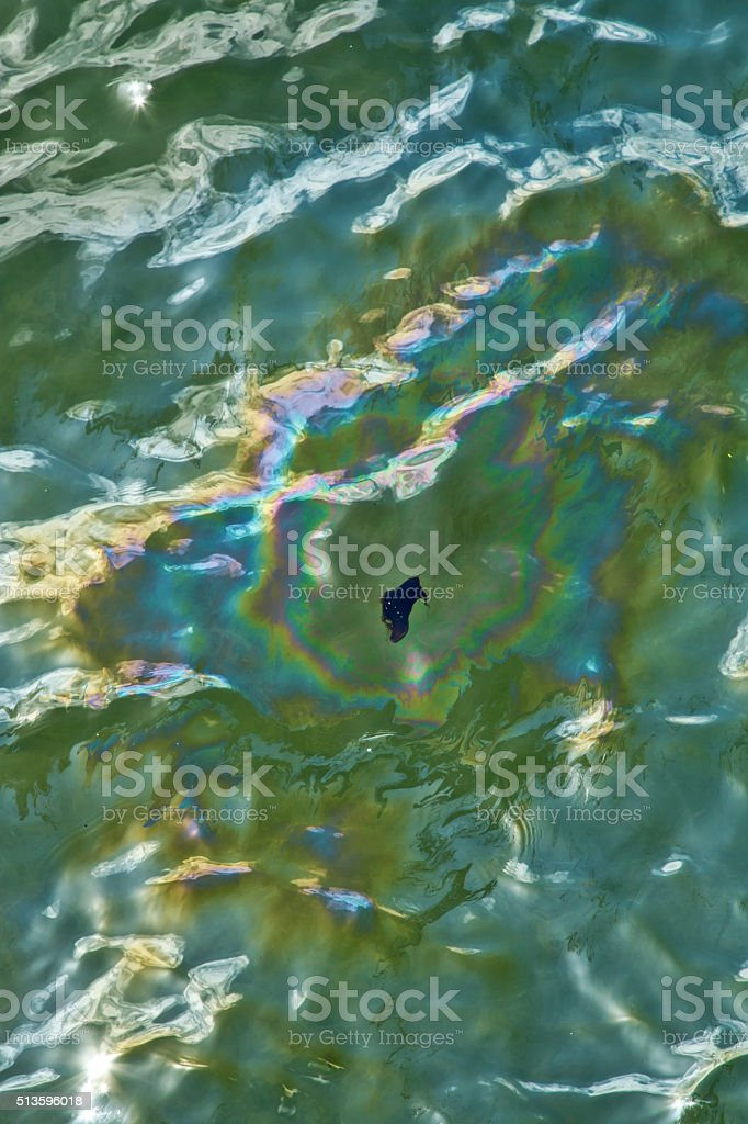Oil leaking from the USS Arizona in Pearl Harbor stock photo