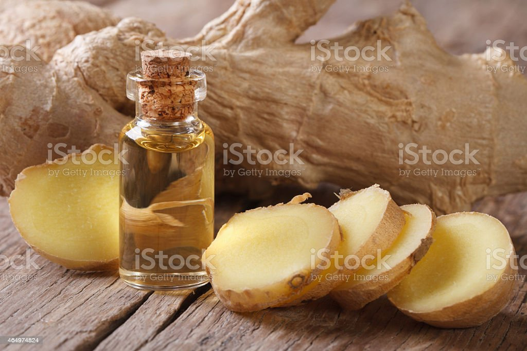 oil of ginger in a small glass bottle macro stock photo
