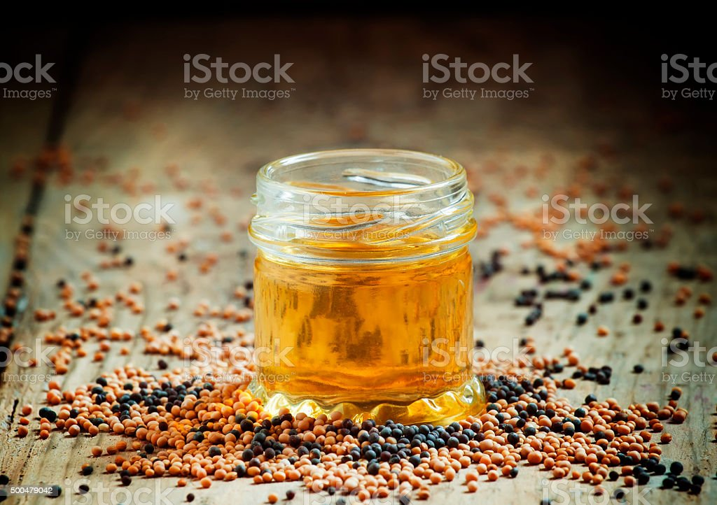 Oil of mustard in a small jar stock photo