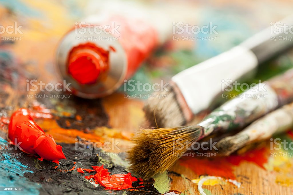 Oil paints and paint brushes stock photo