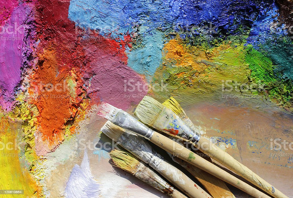 oil paints palette and paint brushes stock photo