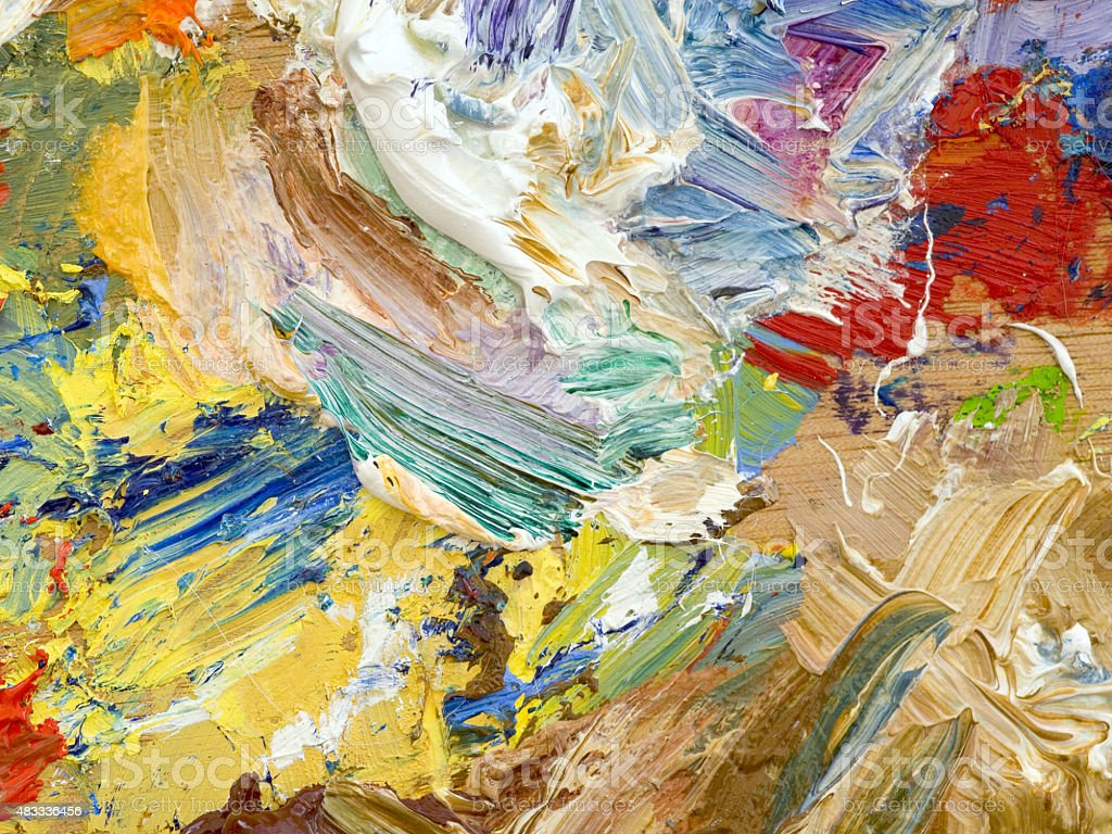 Oil paints palette vibrant multi-coloured full frame background close up stock photo