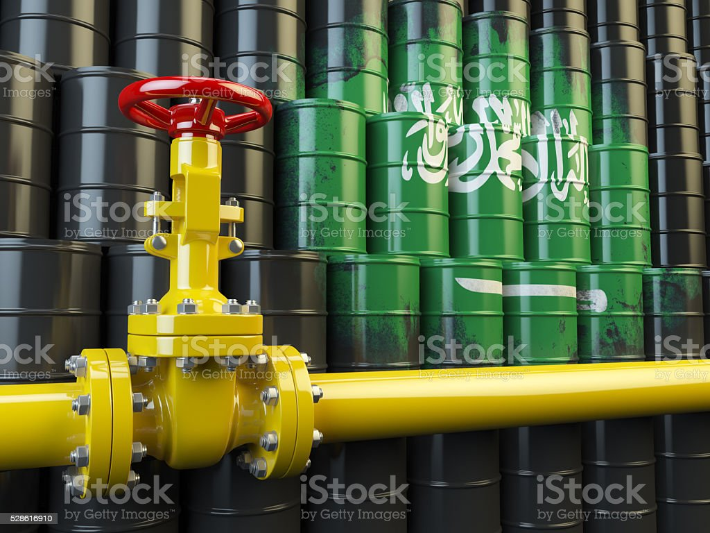 Oil pipe line valve in front of  Saudi Arabia flag stock photo