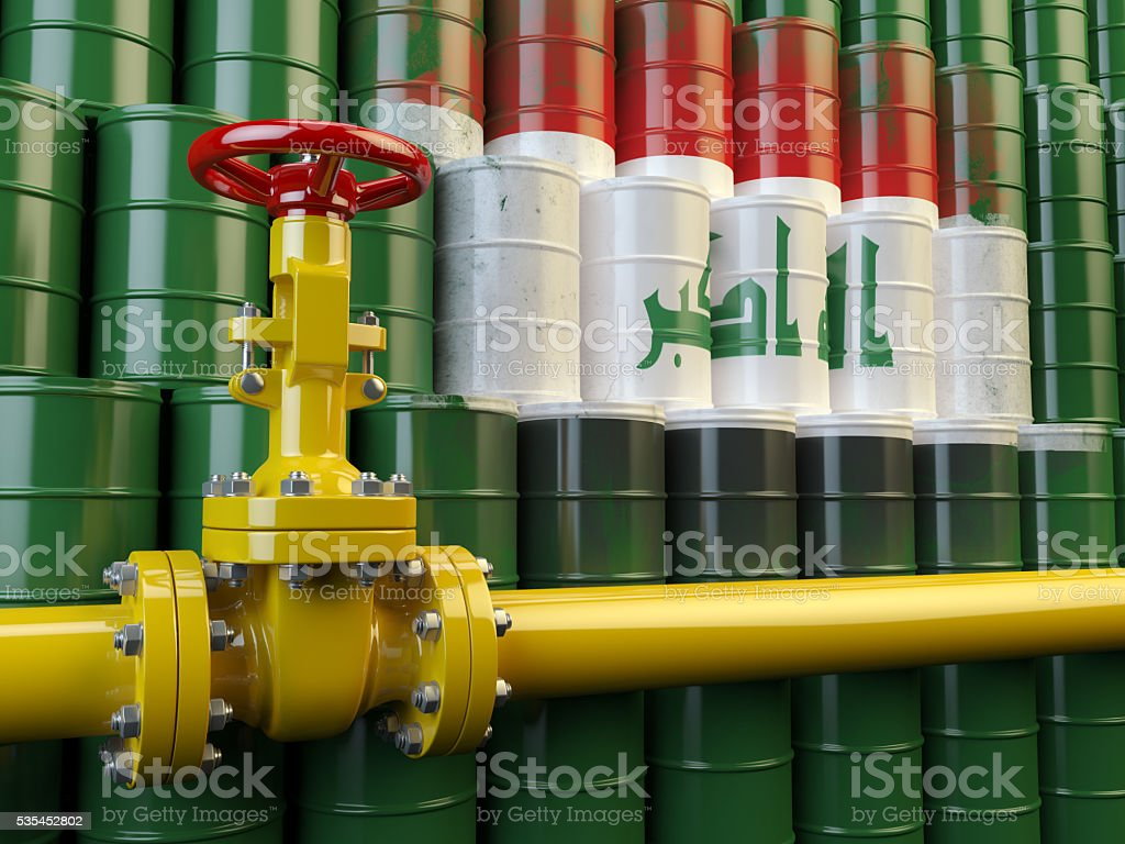 Oil pipe line valve in front of the flag  Iraq stock photo