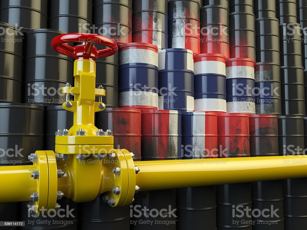 Oil pipe line valve in front of the flag Norway stock photo