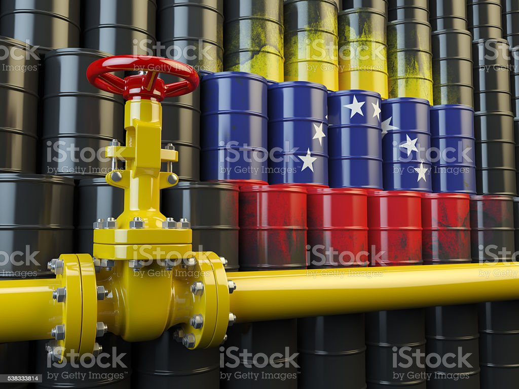 Oil pipe line valve in front of the flag Venezuela stock photo