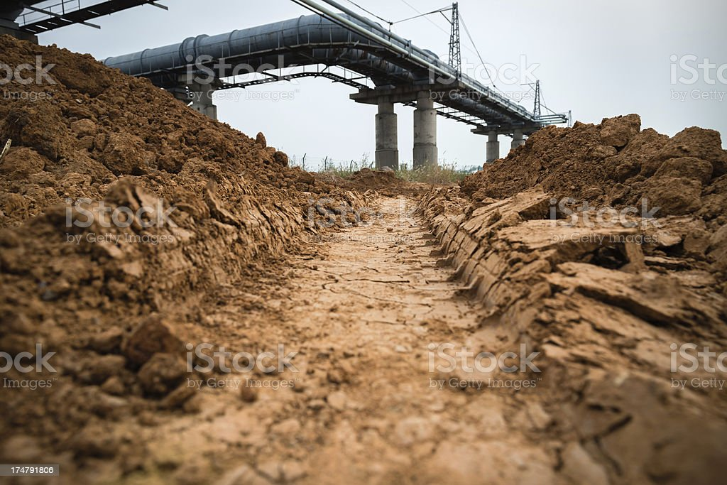 Oil Pipeline and  Dirt Road royalty-free stock photo