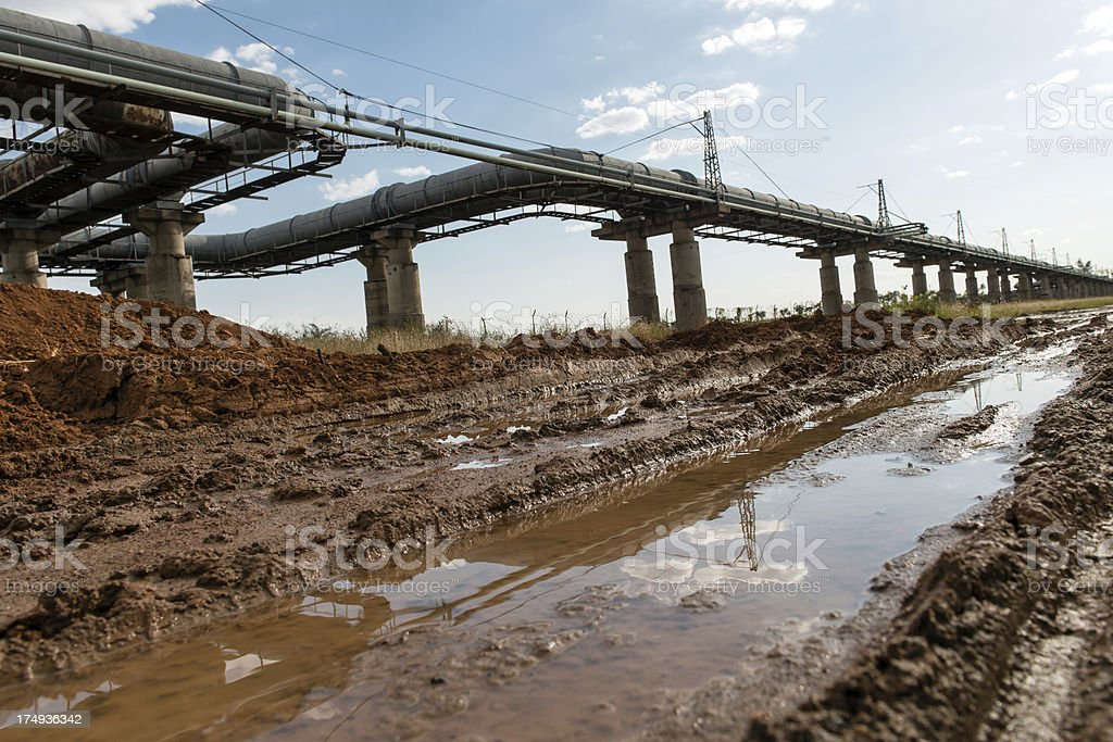 Oil Pipeline and Muddy Road stock photo