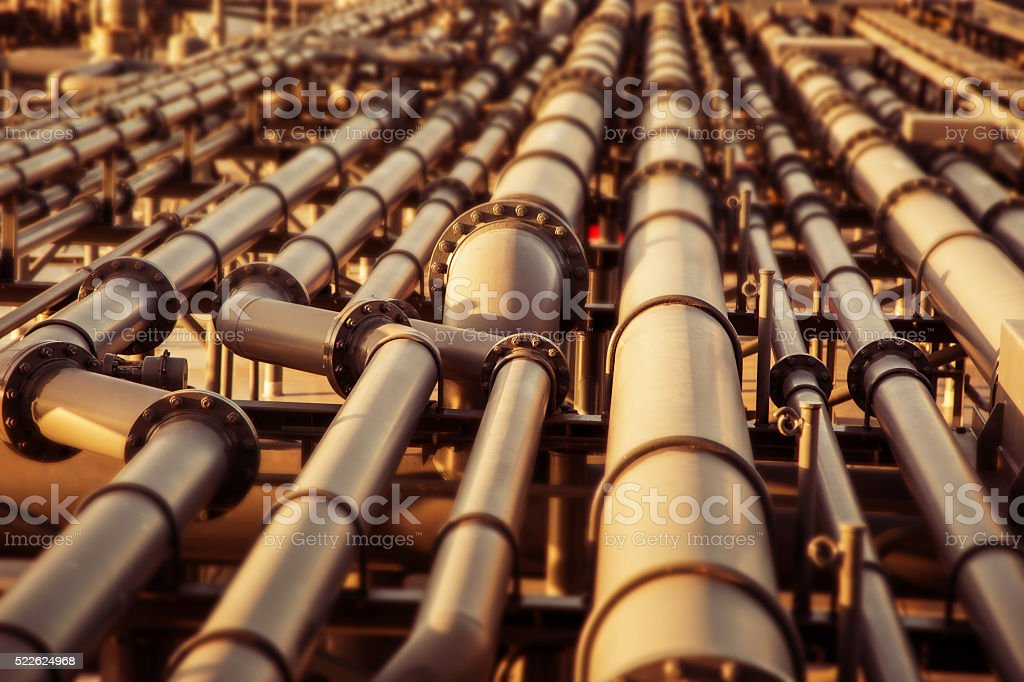 Oil pipeline colored blurred background. stock photo