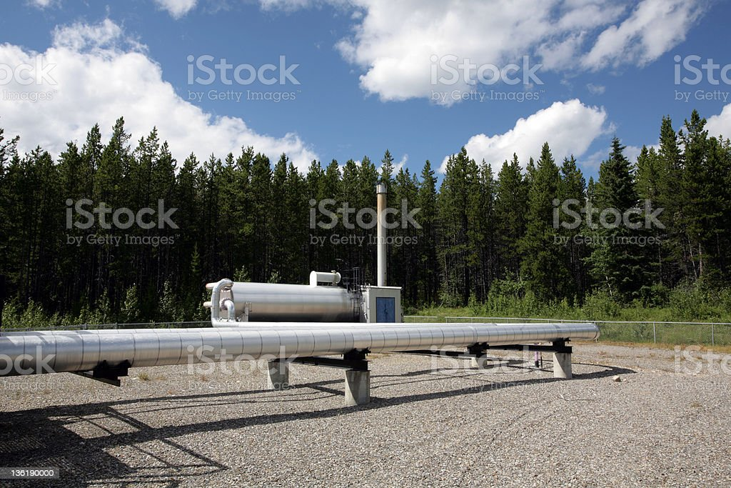 Oil pipeline in the oils fields of Alberta stock photo