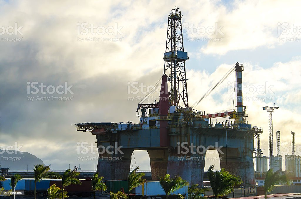 Oil platform at sunrise stock photo