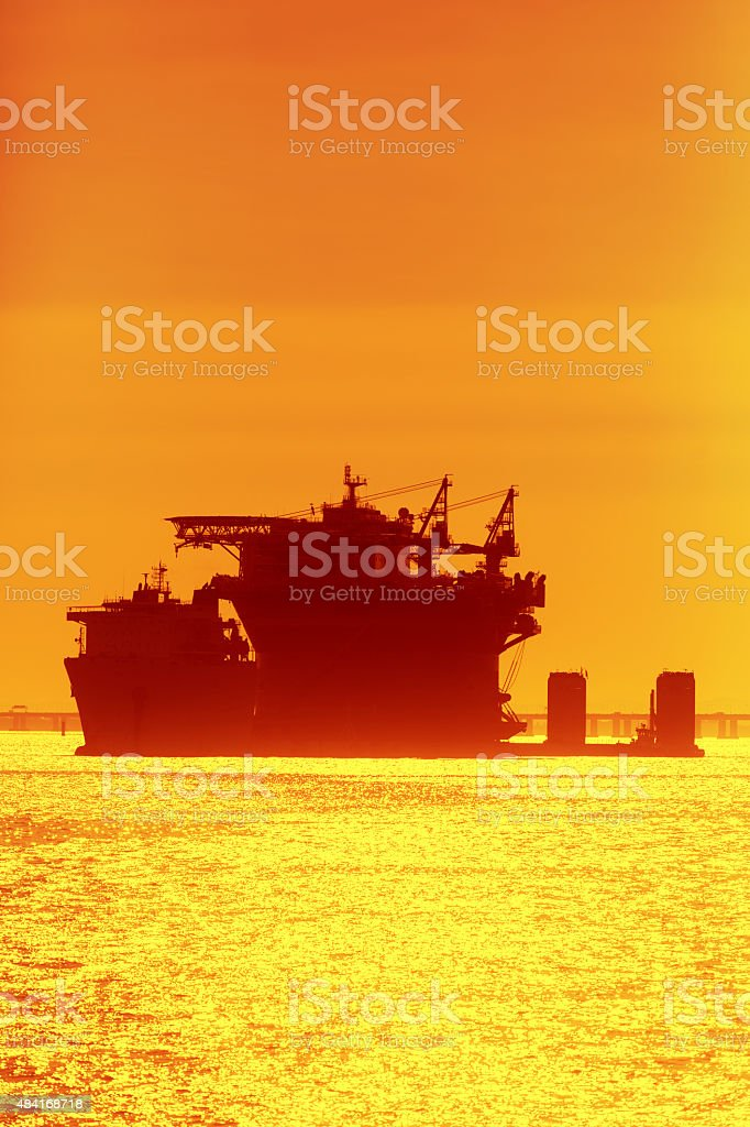 Oil platform being transported stock photo