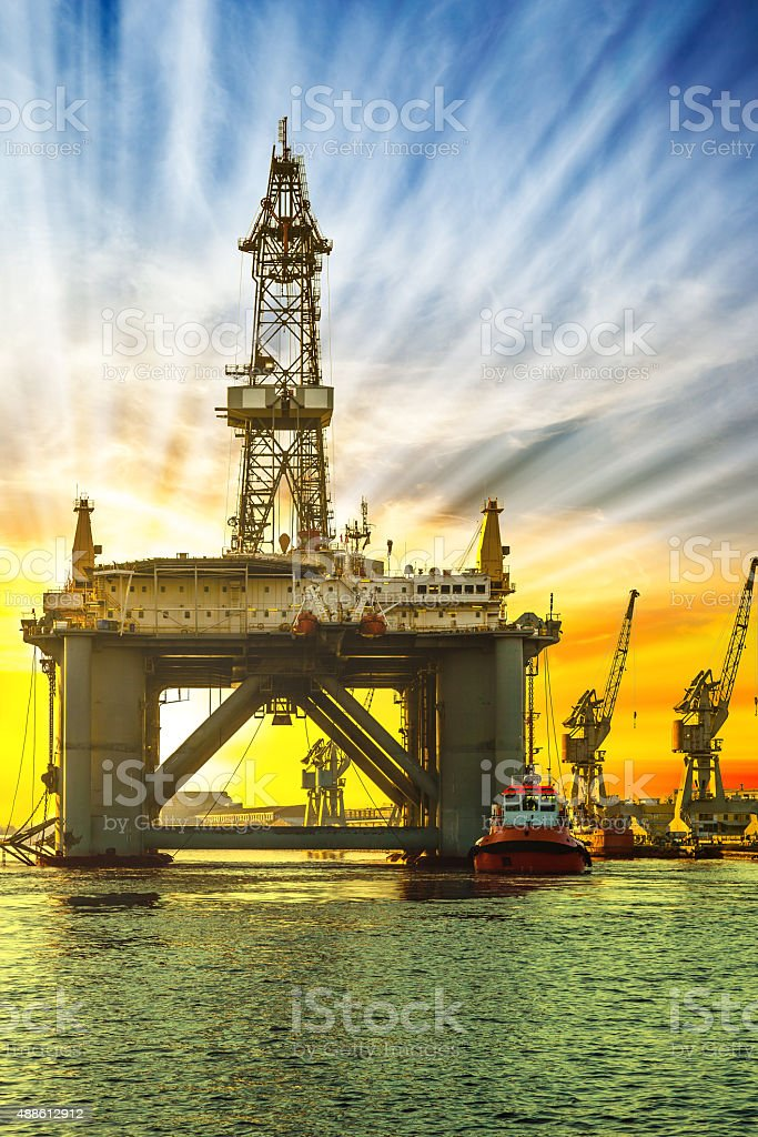 Oil platform in sunset time stock photo
