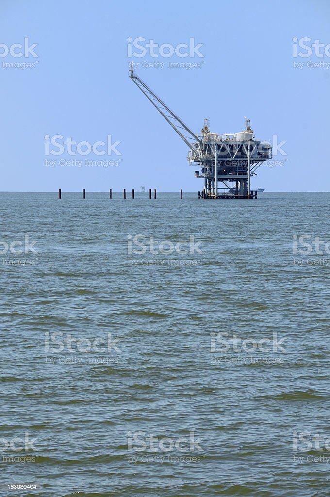 Oil platform near shore royalty-free stock photo