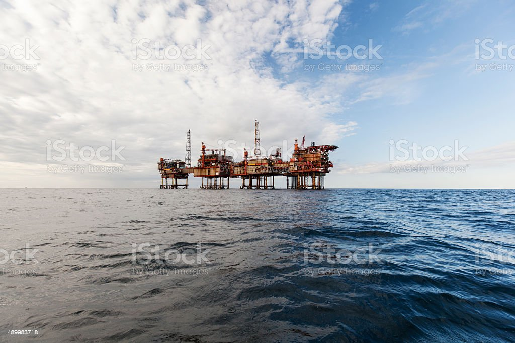 Oil platform on the cloudy day stock photo