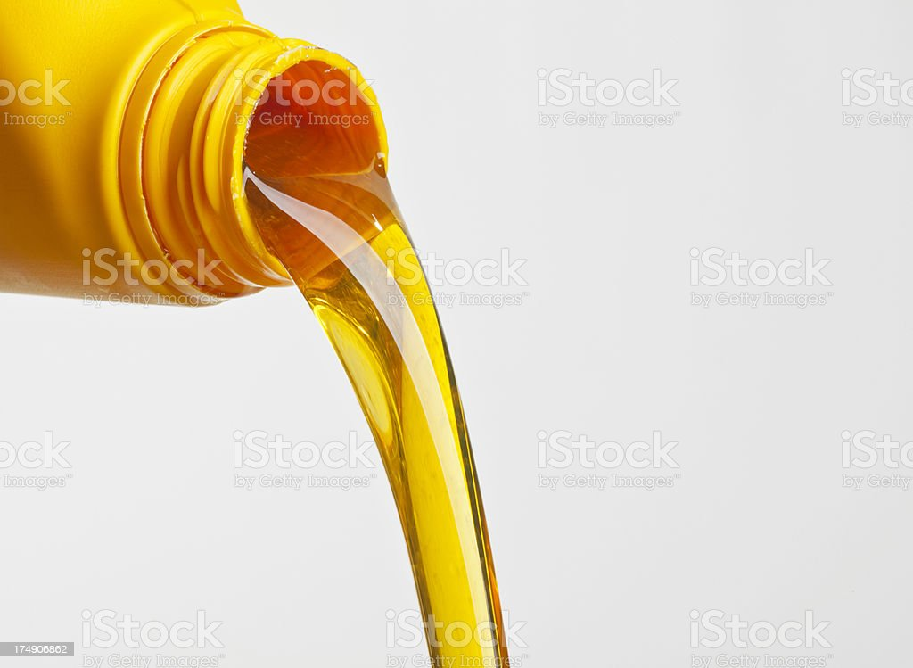 Oil pouring from a plastic bottle stock photo