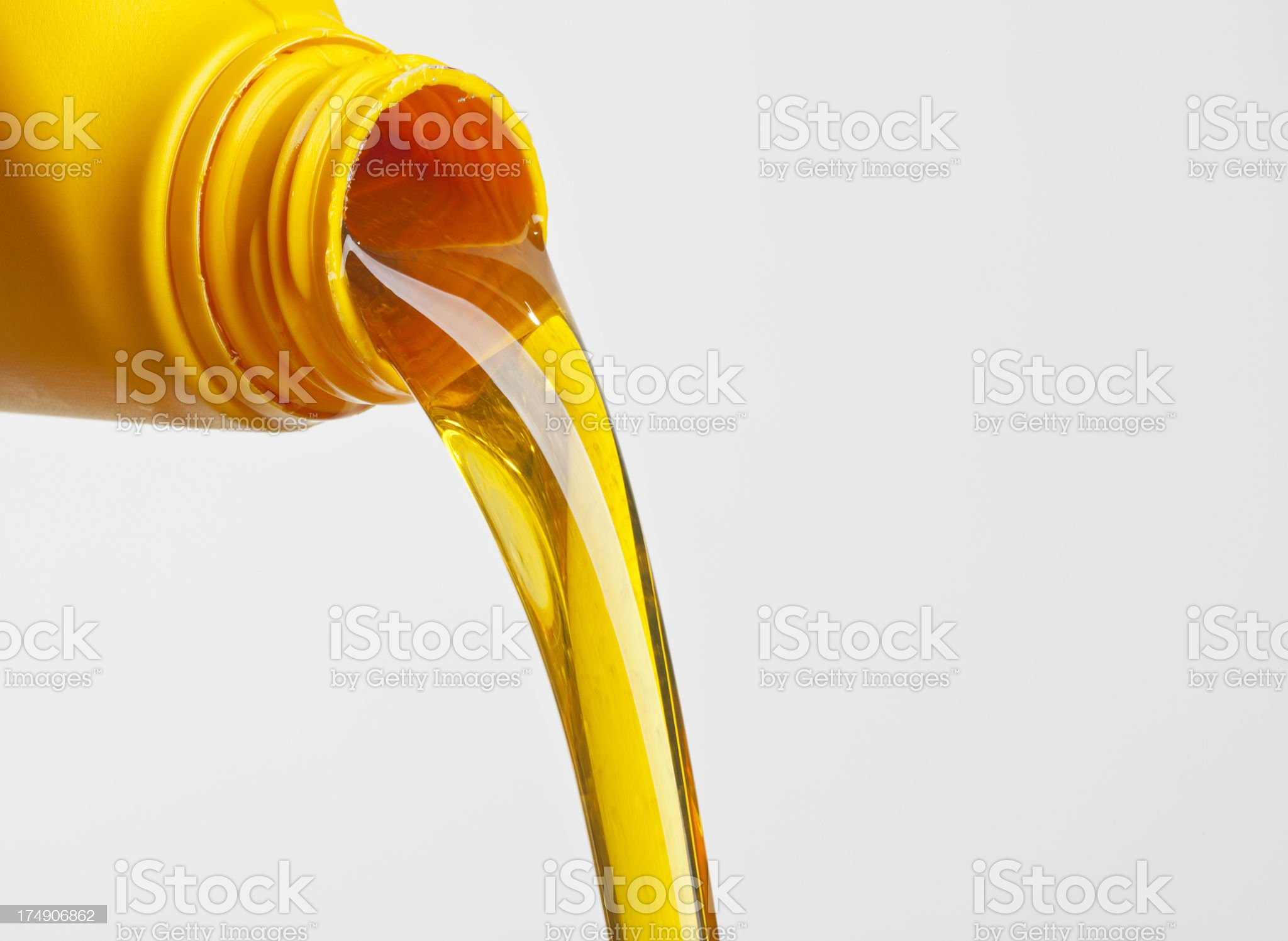 Oil pouring from a plastic bottle royalty-free stock photo