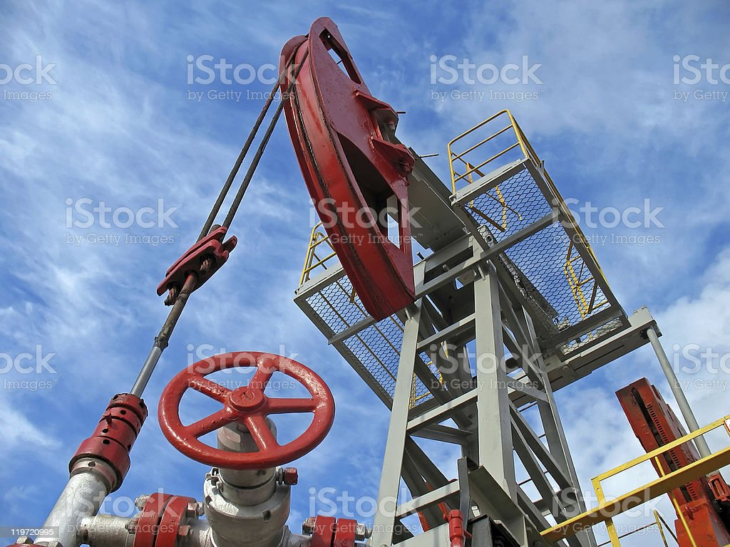 Oil power machine in red and silver royalty-free stock photo