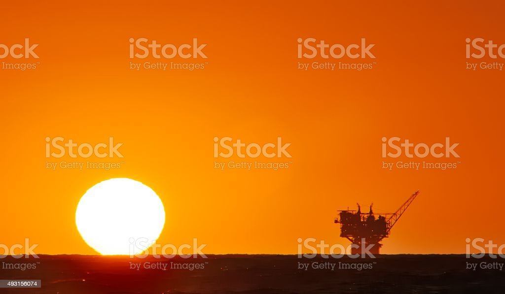 oil production platform and the sun stock photo